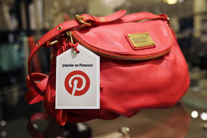 "Photo - This undated image provided by Nordstrom shows a handbag made popular on Pinterest that is available at Nordstrom stores. Pinterest, a social media site that allows users to create collections of photos, articles, recipes, videos and other images that are called ""pins,"" is being used by big chains to draw business to their own sites. (AP Photo/Nordstrom)"