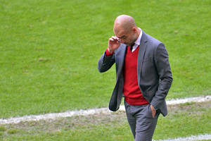 Photo - Bayern head coach Pep Guardiola  walks at the sideline of the pitch  during the  soccer match between FC Bayern Munich and VfB Stuttgart in the Allianz Arena in Munich, Germany, on Saturday, May 10. 2014. (AP Photo/Kerstin Joensson)