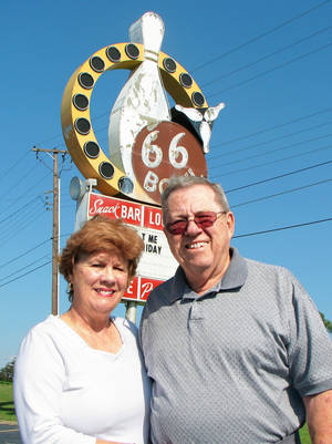 Photo - 66 Bowl owner Jim Haynes and his wife, Peggy, outside the bowling alley during its 50th anniversary last August. The landmark business is being sold to an Indian grocery store. Photo BY ROBERT MEDLEY,  THE OKLAHOMAN Archive