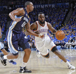Photo - Oklahoma City's James Harden (13) drives past Darrell Arthur (00) of Memphis during game two of the Western Conference semifinals between the Memphis Grizzlies and the Oklahoma City Thunder in the NBA basketball playoffs at Oklahoma City Arena in Oklahoma City, Tuesday, May 3, 2011. Photo by Chris Landsberger, The Oklahoman