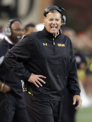 Photo - Maryland coach Randy Edsall shouts at his team in the second half of an NCAA college football game against Wake Forest in Winston-Salem, N.C., Saturday, Oct. 19, 2013. Wake Forest won 34-10. (AP Photo/Chuck Burton)