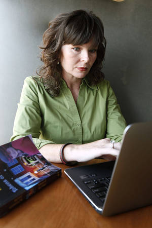 Photo - Betsy Randolph, who is getting her first book  published, works on her writing Thursday in Edmond.  Photo By Paul Hellstern, The Oklahoman