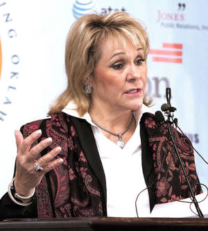Photo - Gov. Mary Fallin announces the state's response to the federal mandate upon the states to implement health care exchanges Monday.  Photo By Paul Hellstern,  The Oklahoman