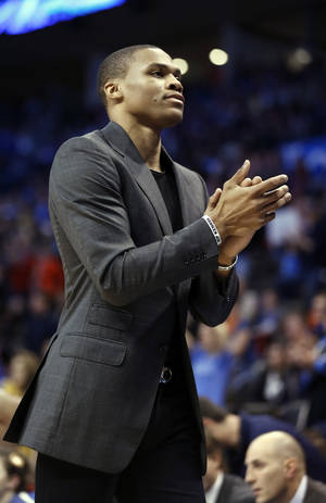 Photo - Thunder's Russell Westbrook cheers on his team in the second half of an NBA basketball game where the Oklahoma City Thunder were defeated 95-93 by the Brooklyn Nets at the Chesapeake Energy Arena in Oklahoma City, on Thursday, Jan. 2, 2014. Photo by Steve Sisney, The Oklahoman