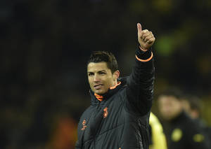 Photo - Real's Cristiano Ronaldo waves to his supporters at the end of the the Champions League quarterfinal second leg soccer match between Borussia Dortmund and Real Madrid in the Signal Iduna stadium in Dortmund, Germany, Tuesday, April 8, 2014. (AP Photo/Martin Meissner)