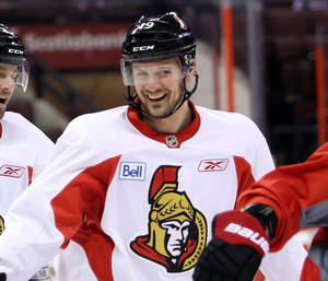 Photo - Ottawa Senators Jason Spezza smiles during NHL hockey practice in Ottawa Saturday, May 18, 2013. Spezza is expected to line up  for Game 3 of the Eastern Conference semifinal series on Sunday, that the Pittsburgh Penguins lead 2-0. (AP Photo/The Canadian Press, Fred Chartrand)