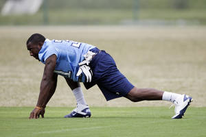 Photo - Tennessee Titans rookie safety Markelle Martin stretches during a workout at the team's NFL football training facility on Friday, June 1, 2012, in Nashville, Tenn. (AP Photo/Mark Humphrey)