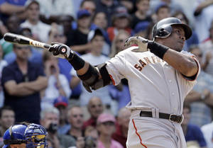 photo - FILE - In this July 19, 2007, file photo, San Francisco Giants' Barry Bonds hits a three-run home run during the seventh inning of a baseball game against the Chicago Cubs in Chicago. With the cloud of steroids shrouding the candidacies of Bonds, Roger Clemens and others, baseball writers on Wednesday, Jan. 9, 2013, might not elect anyone to the Hall of Fame for only the second time in four decades. (AP Photo/M. Spencer Green, File)