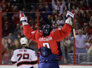 Photo - Washington Capitals left wing Alex Ovechkin, from Russia, celebrates after his second goal of the game in the third period of an NHL hockey game against the New Jersey Devils Saturday, Feb. 23, 2013 in Washington. The Capitals won 5-1. (AP Photo/Alex Brandon)