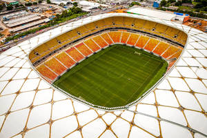 Photo - This photo released by Portal da Copa shows Arena da Amazonia stadium on the day of its inauguration in Manaus in the state of Amazonas, Brazil, Sunday, March 9, 2014. Three stadiums still have to be finished, including the one hosting the opener in Sao Paulo in about three months. (AP Photo/Jose Zamith, Portal da Copa)