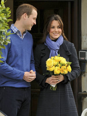 photo - Britain's Prince William stands next to his wife Kate, Duchess of Cambridge as she leaves the King Edward VII hospital in central London, Thursday, Dec. 6, 2012. Prince William and his wife Kate are expecting their first child, and the Duchess of Cambridge has been admitted to hospital suffering from a severe form of morning sickness in the early stages of her pregnancy.  (AP Photo/Andrew Matthews, PA)