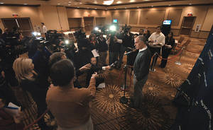 Photo -   U.S. Senator Bob Casey is swarmed by reporters and television cameras during a brief press conference held Tuesday, Nov. 6, 2012 at the Hilton Scranton & Conference Center in downtown Scranton, Pa. Casey is seeking a second, six-year Senate term. (AP Photo/ The Scranton Times-Tribune, Butch Comegys) WILKES BARRE TIMES-LEADER OUT; MANDATORY CREDIT