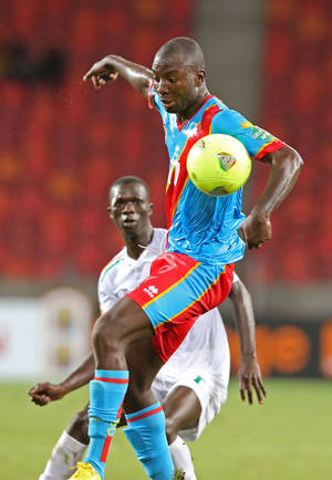 photo - Congo's Cedric Mongongu, jumps for the ball against Niger during their African Cup of Nations Group B soccer match in  Port Elizabeth, South Africa, Thursday, Jan. 24, 2013.  (AP Photo/Schalk van Zuydam)
