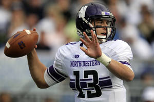 Photo -   Northwestern quarterback Trevor Siemian (13) passes during the first quarter of an NCAA college football game against Penn State in State College, Pa., Saturday, Oct. 6, 2012. (AP Photo/Gene J. Puskar)
