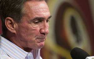 Photo - Former Washington Redskins head coach Mike Shanahan makes a statement after he was fired on Monday, Dec. 30, 2013 at Redskins Park, in Ashburn, Va. Shanahan was fired after a morning meeting with owner Dan Snyder and general manager Bruce Allen. (AP Photo/ Evan Vucci)