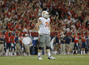 photo - OSU / REACTION: Oklahoma State's Parker Graham (71) reacts to a play during the college football game between the University  of Arizona and Oklahoma State University at Arizona Stadium in Tucson, Ariz.,  Sunday, Sept. 9, 2012. Photo by Sarah Phipps, The Oklahoman