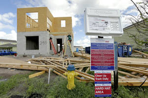 Photo - In this May 14, 2014 photo, a new home is under construction in the Winthrop sub-division in Riverview, Fla. he National Association of Home Builders/Wells Fargo releases its monthly index of builder sentiment on Monday, June 16, 2014. (AP Photo/Chris O'Meara)