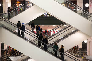 Photo - FILE - In this  Friday, Nov. 29, 2013, file photo, shoppers ride escalators between floors during Black Friday shopping at Macy's, in Chicago.  The Federal Reserve reports how much consumers borrowed in November on Wednesday, Jan. 8, 2014.  (AP Photo/Andrew A. Nelles, File)