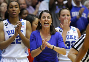Photo - FILE - In this March 22, 2014 photo, Duke coach Joanne P. McCallie urges her team during the first half against Winthrop in a first-round game in the NCAA college basketball tournament in Durham, N.C. (AP Photo/Ted Richardson)