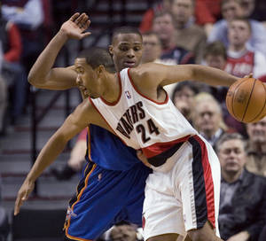 Photo - Portland Trail Blazers guard Andre Miller (24) drives on Oklahoma City Thunder guard Russell Westbrook during the first half of an NBA basketball game in Portland, Ore., Tuesday, Feb. 9, 2010. AP PHOTO