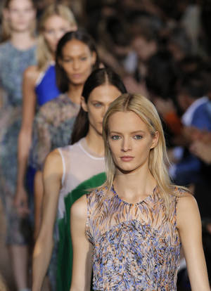 photo -   Models wear creations for British fashion designer Stella McCartney's ready to wear Spring-Summer 2013 collection, presented in Paris, Monday, Oct.1, 2012. (AP Photo/Francois Mori)
