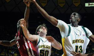 Photo - Baylor's Ekpe Udoh, right, reaches for a loose rebound against Oklahoma's Willie Warren, left, in the first half of an NCAA college basketball game Saturday, Jan. 9, 2010, in Waco, Texas. Looking on for Baylor is Josh Lomers (50). (AP Photo/Waco Tribune Herald, Rod Aydelotte)