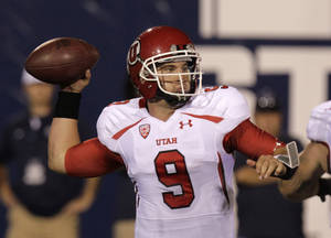 Photo -   Utah quarterback Jon Hays (9)passes the ball during the fourth quarter of an NCAA football game with Utah State Friday, Sept. 7, 2012, in Logan, Utah. Utah State defeated Utah 27-20. (AP Photo/Rick Bowmer)