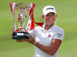 photo - Stacy Lewis of the United States poses with the challenge trophy after winning the HSBC Women's Champions golf tournament on Sunday, March 3, 2013 in Singapore. (AP Photo/Wong Maye-E)
