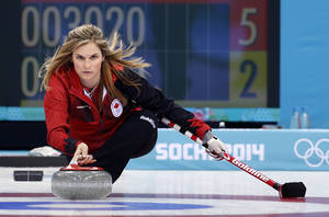 Photo - Canada's skip Jennifer Jones delivers the rock during women's curling competition against Russia at the 2014 Winter Olympics, Saturday, Feb. 15, 2014, in Sochi, Russia. (AP Photo/Robert F. Bukaty)