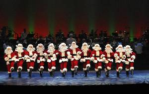 "Photo - A line of Santas dance in the Oklahoma City Philharmonic's ""The Christmas Show."" Photo by Wendy Mutz"