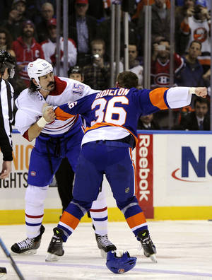 Photo - New York Islanders left wing Eric Boulton (36) and Montreal Canadiens right wing George Parros (15) fight in the first period of an NHL hockey game at Nassau Coliseum in Uniondale, N.Y., Saturday, Dec. 14, 2013. (AP Photo/Kathleen Malone-Van Dyke)
