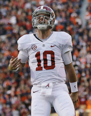 Photo - Alabama quarterback AJ McCarron is one of six finalists for the Heisman Trophy, which will be awarded Saturday night in New York. AP Photo