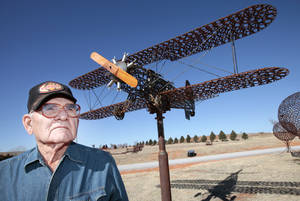 photo - Joe Smith, 86, used horseshoes to build a half-size replica of a Stearman PT-17 Kaydet biplane at his home near Leedey. Besides horseshoes, Smith has used wheelbarrows, wrenches, steam engines and a lot of other metals to build decorated fences, weather vanes, kachina dolls and an eagle perched on the edge of a nest. Photo by David McDaniel,  The Oklahoman