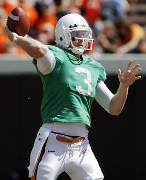 Photo - OSU's Brandon Weeden (3) passes the ball during the Orange/White spring football game for the Oklahoma State University Cowboys at Boone Pickens Stadium in Stillwater, Okla., Saturday, April 16, 2011. Photo by Nate Billings, The Oklahoman