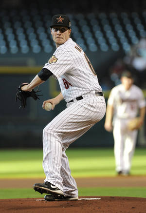 photo -   Houston Astros' Lucas Harrell delivers a pitch against the San Diego Padres in the first inning of a baseball game Wednesday, June 27, 2012, in Houston. (AP Photo/Pat Sullivan)