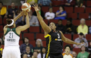 Tulsa Shock's Courtney Paris (3) defends against Seattle Storm's Tianna Hawkins in the first half of a preseason WNBA basketball game Friday, May 17, 2013, in Seattle. (AP Photo/Elaine Thompson)