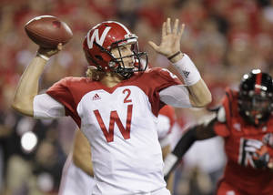 Photo -   Wisconsin quarterbak Joel Stave throws in the first half of an NCAA college football game against Nebraska, in Lincoln, Neb., Saturday, Sept. 29, 2012. (AP Photo/Nati Harnik)