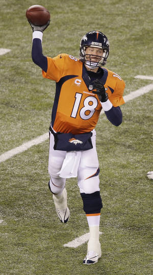 Photo - Denver Broncos' Peyton Manning works against the Seattle Seahawks during the second half of the NFL Super Bowl XLVIII football game Sunday, Feb. 2, 2014, in East Rutherford, N.J. (AP Photo/Charlie Riedel)