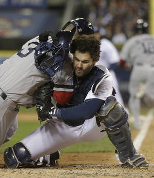 Photo - Boston Red Sox's David Ross is out at home on a fielder choice collides with Detroit Tigers catcher Alex Avila in the second inning during Game 5 of the American League baseball championship series Thursday, Oct. 17, 2013, in Detroit. (AP Photo/Matt Slocum)