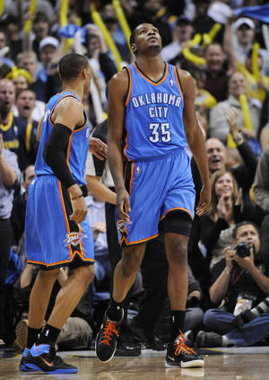 Photo - Oklahoma City Thunder forward Kevin Durant (35) reacts during the second half in game 4 of a first-round NBA basketball playoff series against the Denver Nuggets Monday, April 25, 2011, in Denver. Denver beat Oklahoma 104-101. Oklahoma City leads the series 3-1. (AP Photo/Jack Dempsey)