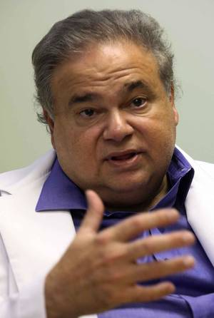 Photo - This July 20, 2009 photo shows Dr. Salomon Melgen at his office in West Palm Beach, Fla. Sen. Robert Menendez's office says he reimbursed Melgen, a prominent Florida political donor, $58,500 on Jan. 4 of this year for the full cost of two of three trips Menendez took Melgen's plane to the Dominican Republic in 2010. (AP Photo/The Miami Herald, Hector Gabino)