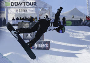Photo - Shaun White competes during the men's snowboarding superpipe final at the Dew Tour iON Mountain Championships, Saturday, Dec. 14, 2013, in Breckenridge, Colo. White placed second in the event behind Greg Bretz (AP Photo/Julie Jacobson)
