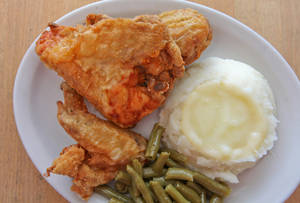 "Photo - This undated image supplied by Yoder's Restaurant in Sarasota, Fla., shows the restaurant's fried chicken, one of its most popular entrees. The restaurant serves ""homestyle Amish food"" and is extremely popular among locals and tourists alike.  (AP Photo/Courtesy of Yoder's Restaurant)"