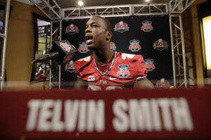 Photo - Florida State's Telvin Smith answers a question during media day for the NCAA BCS National Championship college football game Saturday, Jan. 4, 2014, in Newport Beach, Calif. Florida State plays Auburn on Monday, Jan. 6, 2014. (AP Photo/David J. Phillip)
