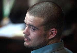 photo -   FILE - In this Jan. 11, 2012 file photo, Joran van der Sloot looks back from his seat after entering the courtroom for the continuation of his murder trial at San Pedro prison in Lima, Peru. Joran van der Sloot is serving a 28-year sentence for killing a Lima woman he met at a casino. The lawyer for Joran van der Sloot says his client will fight extradition from Peru to the U.S., where he is charged with extortion and wire fraud. (AP Photo/Karel Navarro, File)  