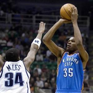 photo - Oklahoma City Thunder guard Kevin Durant (35) shoots against Utah Jazz forward C.J. Miles (34) during the first quarter of the NBA basketball game Friday, Nov. 7, 2008, in Salt Lake City. AP Photo