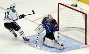 Photo - Dallas Stars center Rich Peverley (17) scores against Colorado Avalanche goalie Semyon Varlamov (1), of Russia, in the first period of an NHL hockey game in Denver on Tuesday, Oct. 15, 2013. (AP Photo/Joe Mahoney)