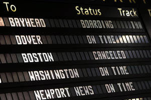 Photo - The Amtrak departures board shows a canceled train to Boston at Penn Station, Friday, April 19, 2013 in New York.  Mass transit to and from the Boston area was virtually shut down Friday as police conducted a massive manhunt for a suspect in Monday's Boston Marathon bombing. (AP Photo/Jason DeCrow)