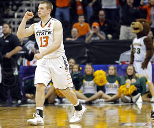 photo - OKLAHOMA STATE UNIVERSITY / OSU / BIG 12 TOURNAMENT / COLLEGE BASKETBALL / CELEBRATION: Oklahoma State's Phil Forte (13) celebrates the Cowboys' win following  the Phillips 66 Big 12 Men's basketball championship tournament game between Oklahoma State University and Baylor at the Sprint Center in Kansas City, Thursday, March 14, 2013. Photo by Sarah Phipps, The Oklahoman