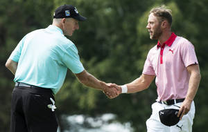 Photo - Graham DeLaet, of Canada, right, shakes hands with Jim Furyk following their second round of play at the Canadian Open golf championship Friday, July 25, 2014 in Montreal. (AP Photo/The Canadian Press, Paul Chiasson)